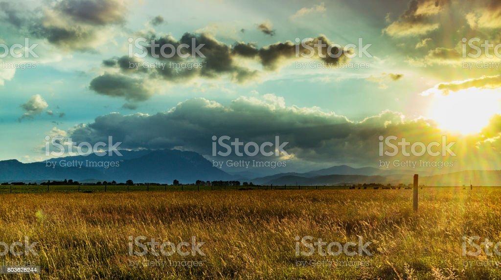 Golden Sunset over farmland in the Carpathian Mountains Romania stock photo