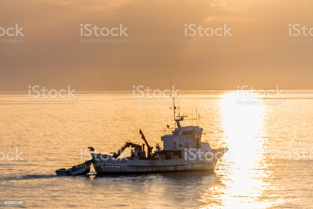 Golden Sunset with Boat on the Mediterranean stock photo