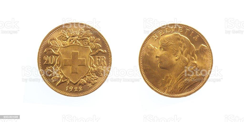 Golden Swiss 20 Franc Coin Helvetia stock photo