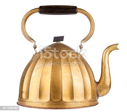 Vintage golden tea kettle isolated on white background