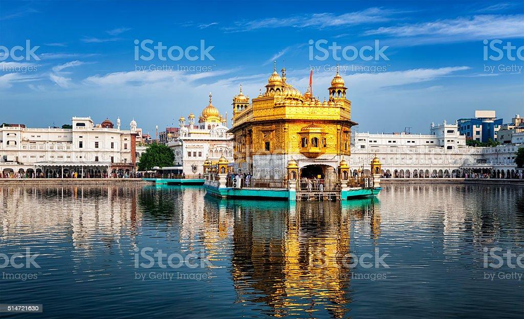 Golden Temple, Amritsar Panorama of Sikh gurdwara Golden Temple (Harmandir Sahib) and water tank. Amritsar, Punjab, India Amritsar Stock Photo