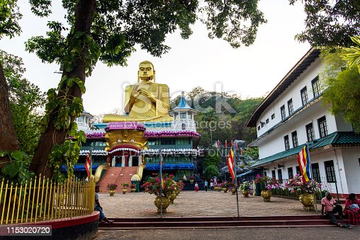 Dambulla, Sri Lanka - March 30, 2019: Golden temple with big Buddha statue near Dambulla cave temple complex in Sri Lanka