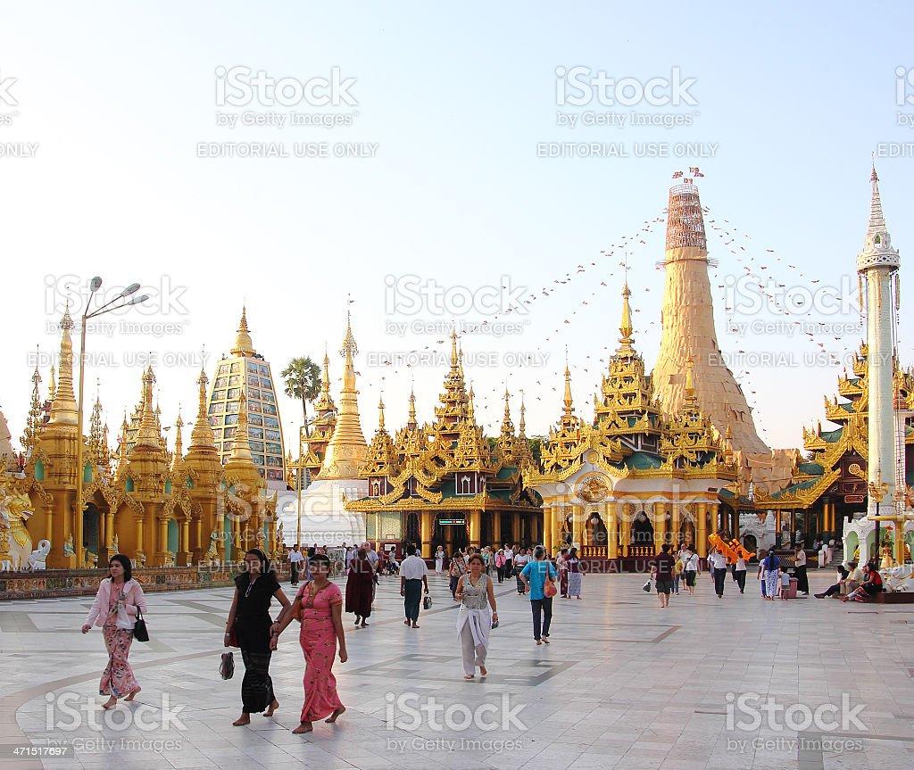 golden temples and burmese believers in Shwedagon pagoda, Yangon royalty-free stock photo