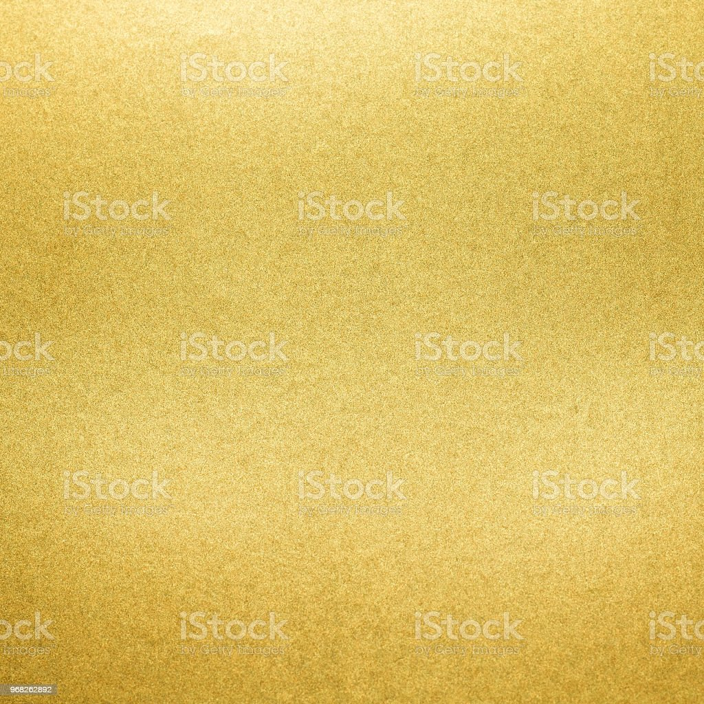 Golden texture background. Paper glitter material. stock photo
