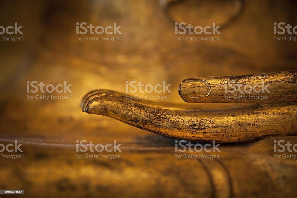 golden thai buddha hand detail stock photo