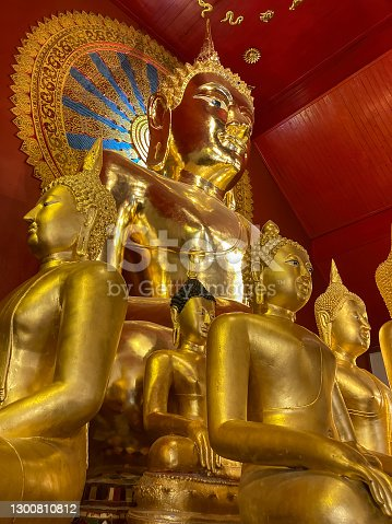 This famous ancient Thai Buddhist temple is a popular tourist attraction and sits within the old city walls of Chiang Mai. here many golden Buddha images sit in the main Viharn or the main building of the temple.