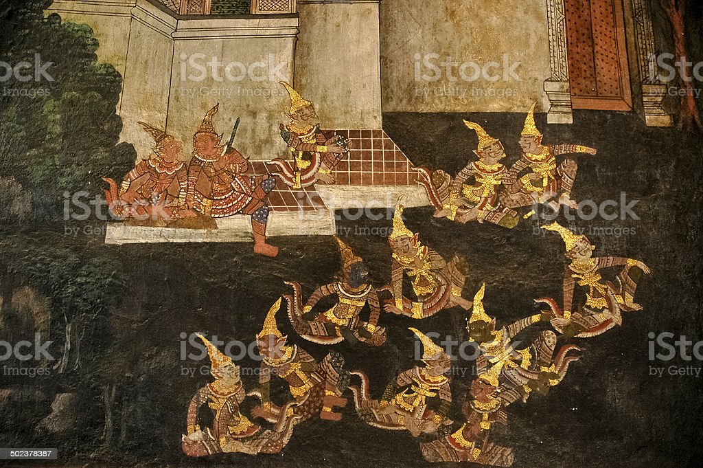 Golden Thai Ramayana drawing on a wall stock photo