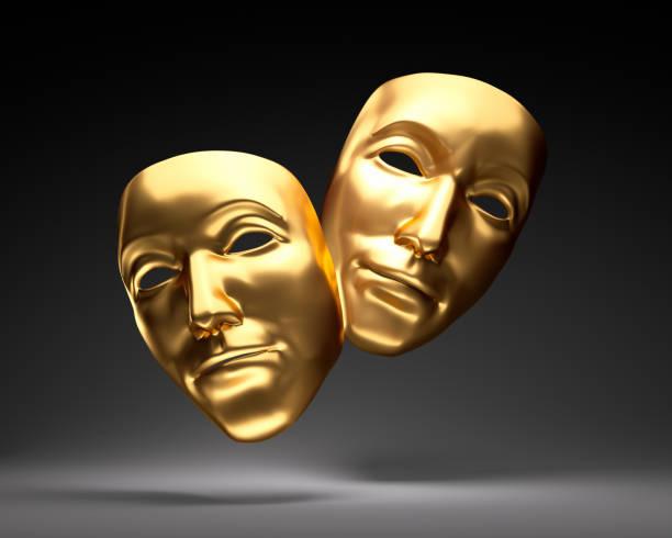 Golden theater masks stock photo