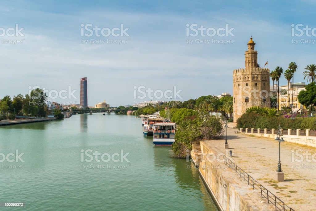 Golden tower or Torre del Oro along the Guadalquivir river, Seville, Andalusia, Spain. stock photo