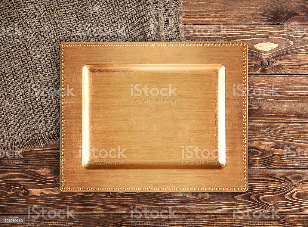 golden tray on wooden table