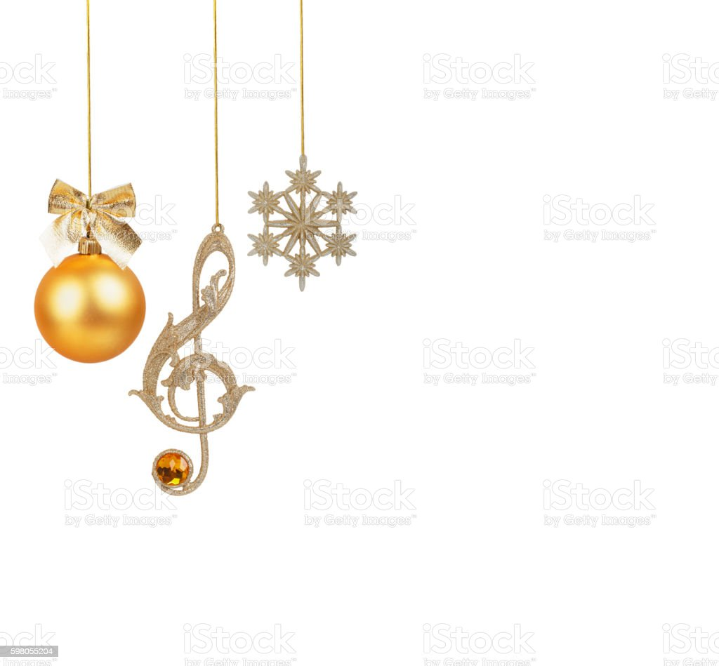Golden treble clef, snowflake and Christmas ball stock photo