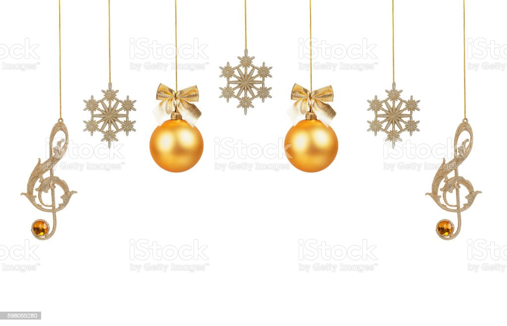 Golden treble clefs, snowflakes and Christmas balls stock photo