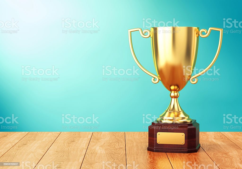Golden trophy cup on table stock photo