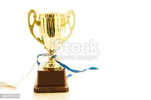 istock Golden trophy isolated 904297104