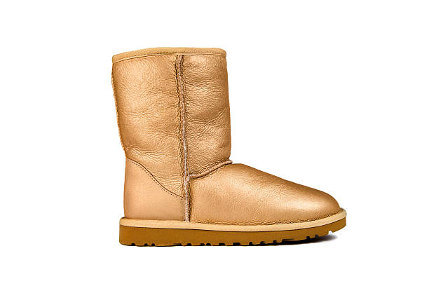 golden ugg boot - lammfellstiefel stock-fotos und bilder