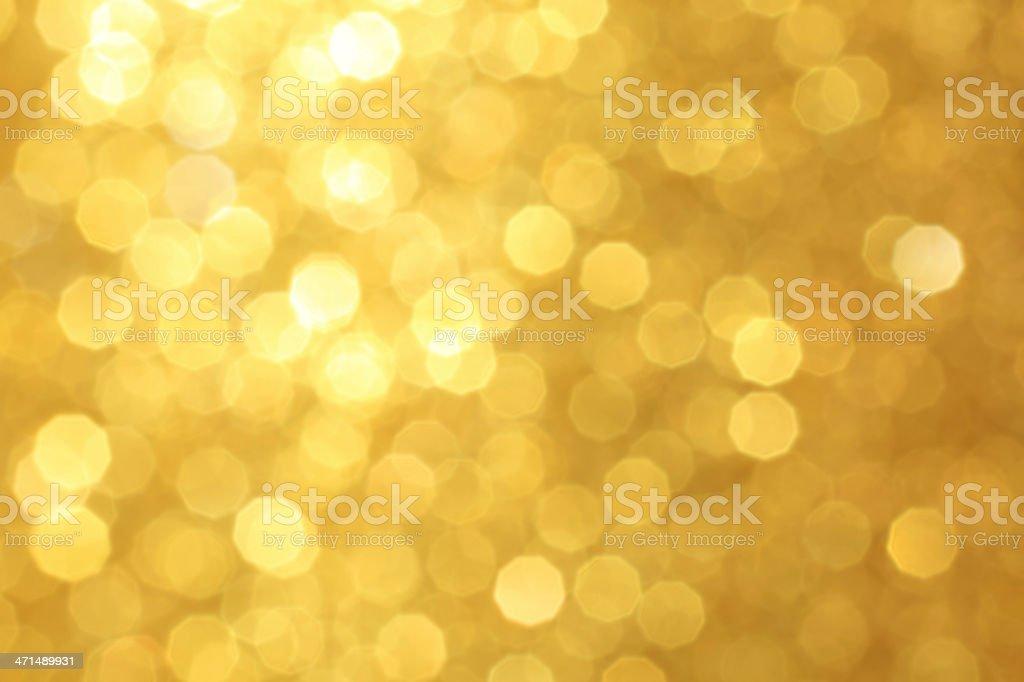 Golden unfocused light background stock photo