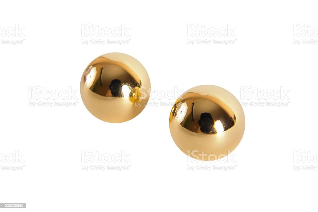 Golden vaginal balls isolated on a white background stock photo