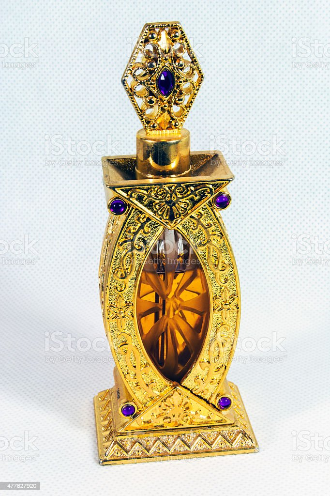Golden vial with aromatic oil, a bottle of perfume stock photo