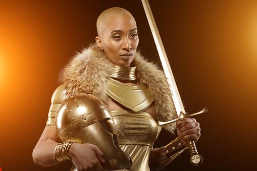Golden viking inspired warrior female in studio shot