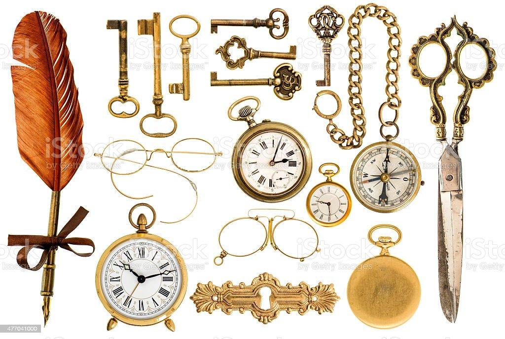 Golden vintage accessories. Antique keys, clock, glasses, scissors, compass stock photo