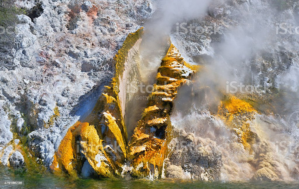 Golden volcanic steam vent stock photo