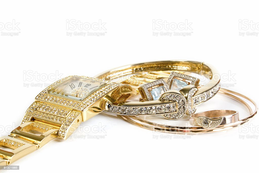 Golden watch and jewellery stock photo