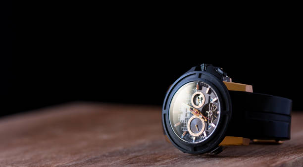 Golden Watch Golden watch with wooden table luxury watch stock pictures, royalty-free photos & images