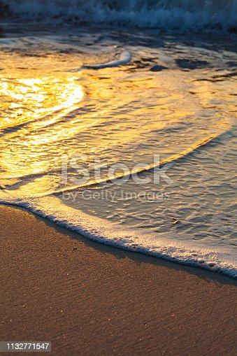 Golden waves reach the Beach of Pantar Island, it