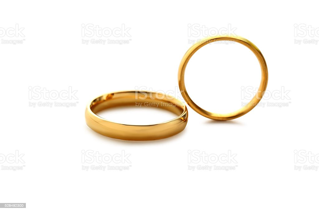 Golden wedding rings isolated on a white stock photo