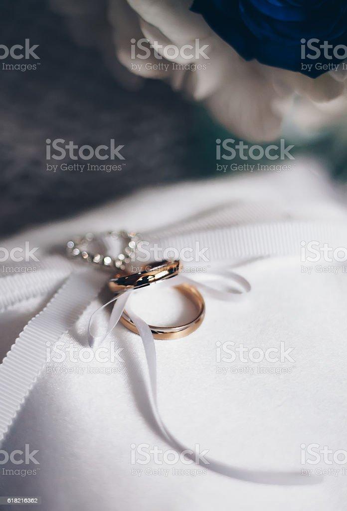 Golden Wedding Rings With Wedding Decoration Stock Photo