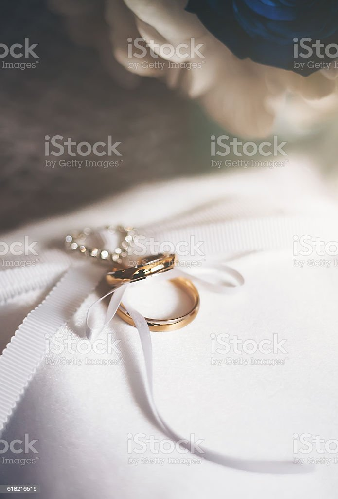 Golden wedding rings with wedding decoration stock photo