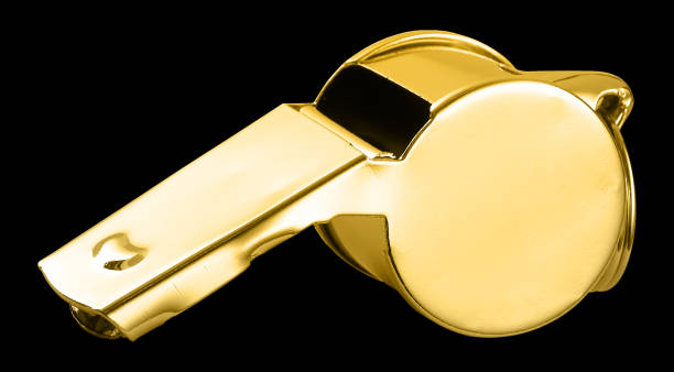 golden whistle isolated against the black background - loudon stock photos and pictures