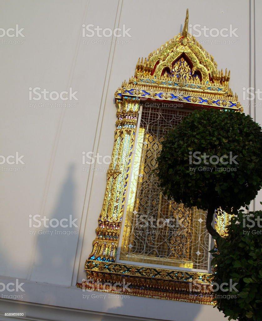 Golden window on a thai temple stock photo