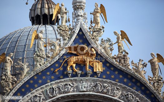 Golden Winged Lion on the Basilica of Saint Mark in Venice in Italy. The Lion is the symbol of the italian island
