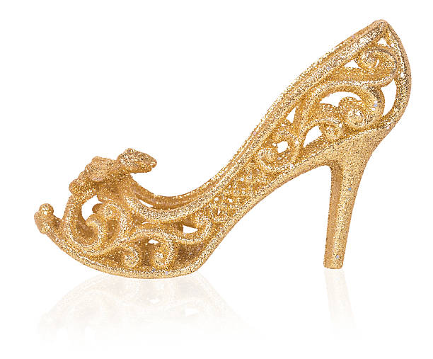 golden women shoe, christmas decoration - prinzessinnenschuhe stock-fotos und bilder