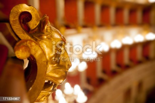 Golden wood lion, etail of boxes of Baroque Italian Theater in Reggio Emilia (first opening the April 21, 1857). Horizontal shot.