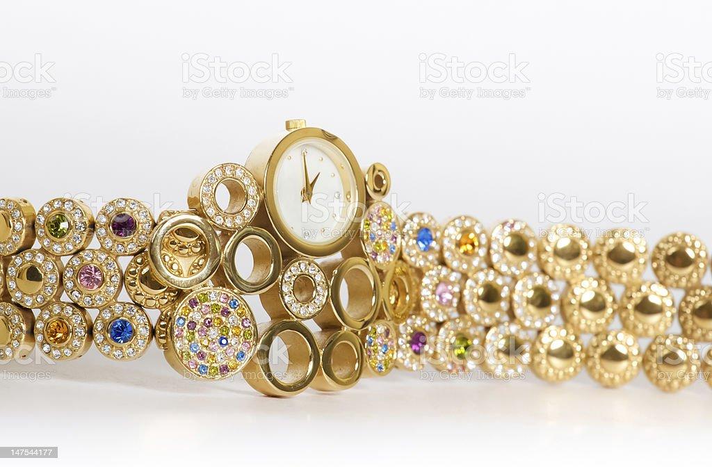 Golden wristwatch with gems stock photo