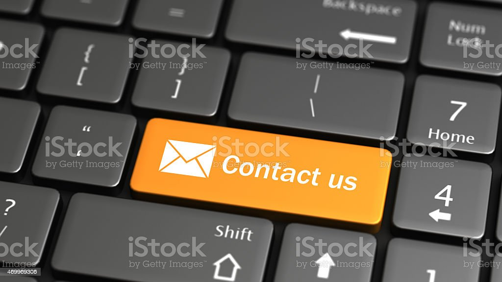 Golden yellow contact us button on a computer grey keyboard stock photo