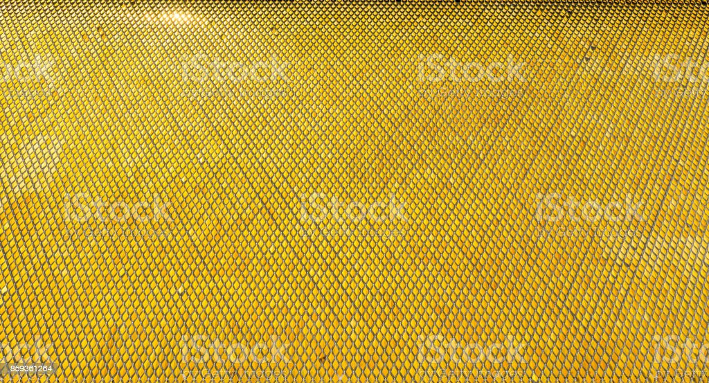Golden yellow geometric shiny elements with reflection of sunlight stock photo