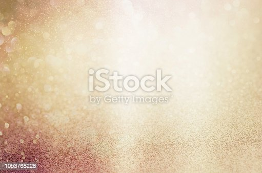 golden yellow glittering Christmas lights. Blurred abstract background