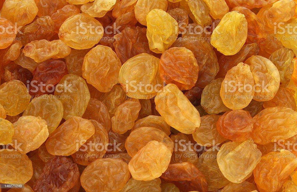 Golden yellow raisins background stock photo