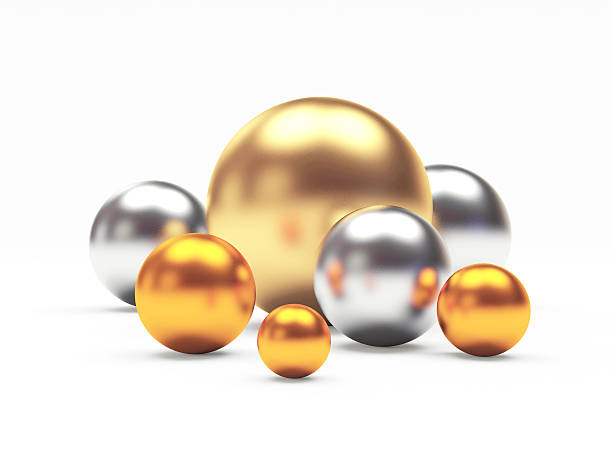 Golden,silver and bronze or cooper spheres of different diameters. stock photo