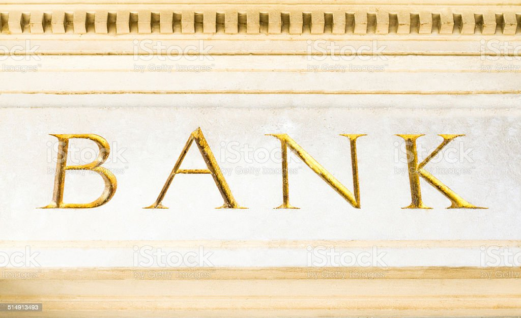 Gold-Leaf 'BANK' Inscription, Engraved in Marble stock photo