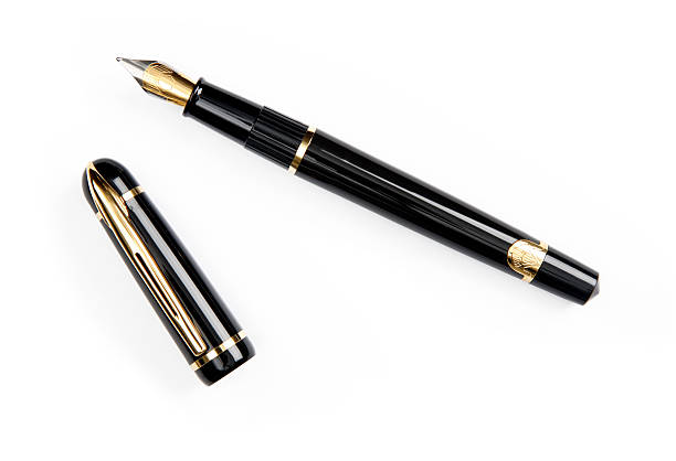 A gold-nibbed fountain pen on a white background stock photo