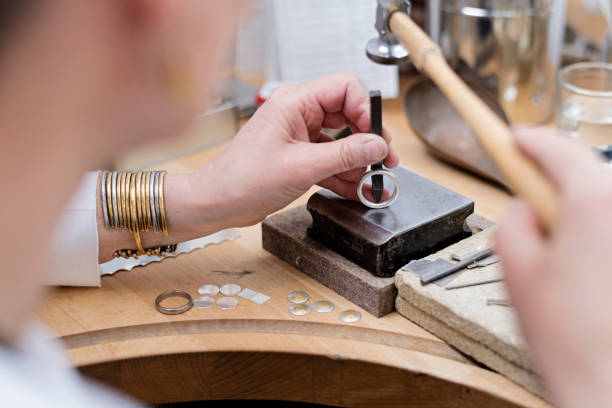 goldsmith at work. - ring jewelry stock photos and pictures