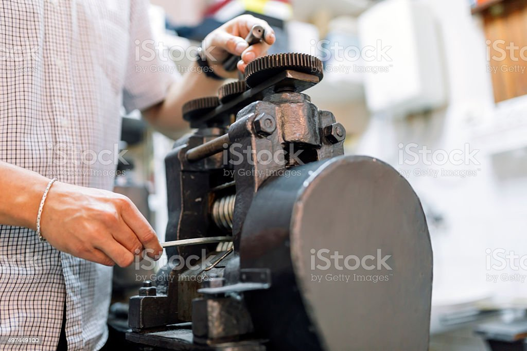 Goldsmith crafting metal stock photo
