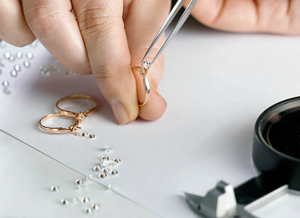 goldsmith jeweler puts gem to the ring jeweller stock pictures, royalty-free photos & images