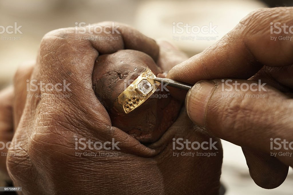 Goldsmith with ring stock photo