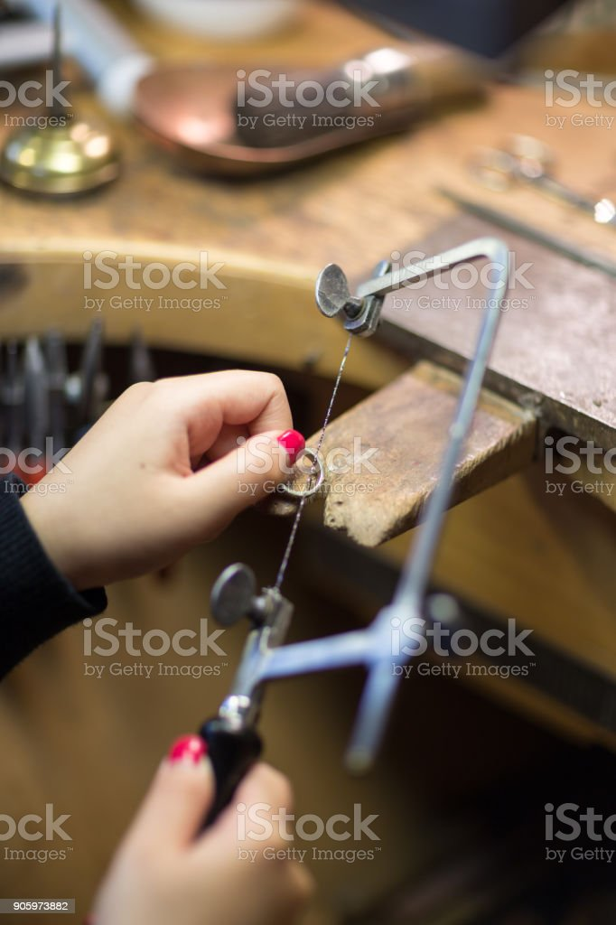 Goldsmith with tools stock photo