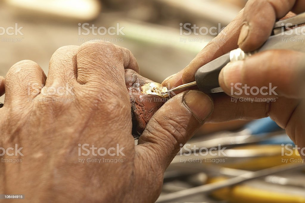 A goldsmith working on a diamond ring royalty-free stock photo